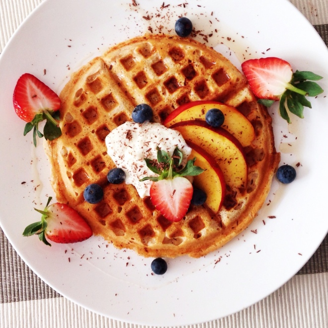 Vanilla waffle with nectarine, strawberries, blueberries, salted caramel and vanilla bean whipped ricotta and yoghurt.
